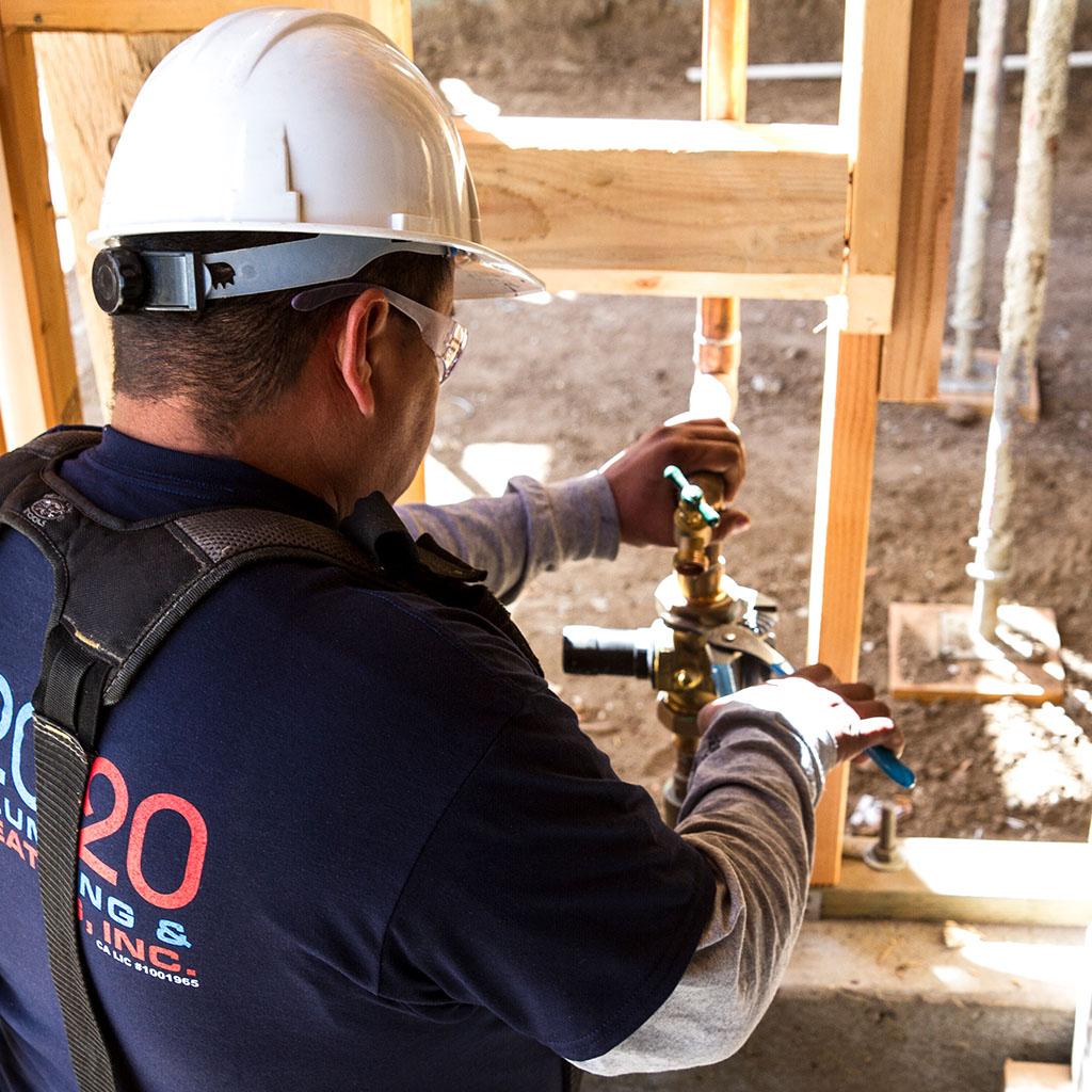 installing plumbing pipes