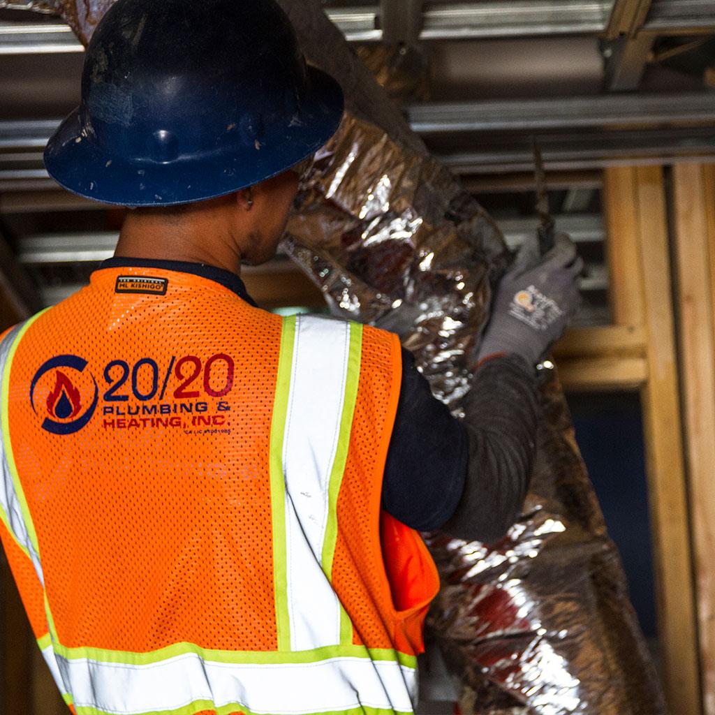 worker installing AC